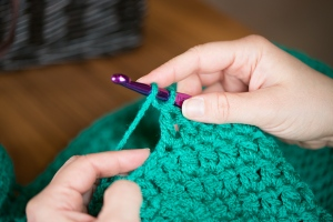 Second: Yarn Over Hook (yoh) so the yarn hangs in front of the hook as pictured.